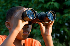 boy birding with binoculars
